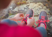 Young runner tying shoelaces — Stock Photo