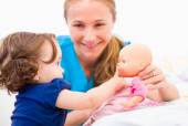 Adorable baby and babysitter — Stock Photo