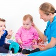 Two adorable baby at the doctor — Stock Photo #62251519