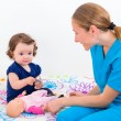 Adorable baby at the doctor — Stock Photo #62618843