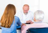 Elderly woman at the doctor — Stock Photo