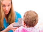Baby with nanny — Stock Photo