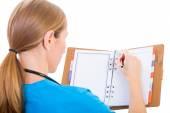 Young doctor writing report — Foto de Stock