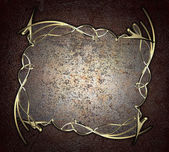 Old scratched plate with gold trim on brown background. Design template. Design site — Stock Photo