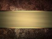 Rusty metal texture with gold ribbon — Stockfoto