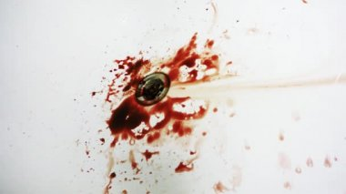 Dripping blood in the bathroom and falls bloody knife — Stock Video