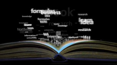 The concept of the word education. Word cloud emitted from the book — Stock Video