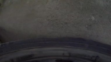 Car's wheels in mud in the forest, off-road. Driving at country road. View from outside car cabin. POV — Stock Video