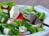 Leaf vegetable salad with feta cheese closeup — Stock Photo