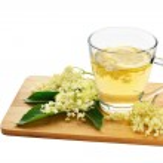 Elderflower tea and blossoms isolated — Stock Photo #75147871