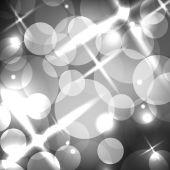 Abstract gray bokeh background — Stock Vector