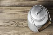Aluminum old milk can on a wooden background in the horizontal format — Stock Photo