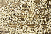 Natural of oat grains on a wood in horizontal format — Stock Photo