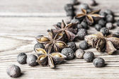 Allspice peas and the star anise on a wooden background — Stock Photo
