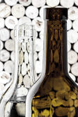Wine bottles on corks background in vertical format — Stock Photo