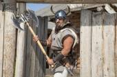 Strong Viking outside his home — Stock Photo