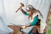Strong viking is repairing his sword — Stock Photo