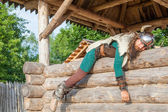 Viking is resting on his house territory — Stock Photo