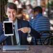 One relaxed young handsome professional businessman working with his laptop, phone and tablet in a noisy cafe. — Stock Photo #81254496