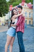 Happy young couple laughing in the city. Love Story series. — Stock Photo