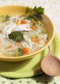 Broccoli soup with chicken, carrots, potatoes and parsley . — Stock Photo