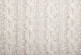 Braids pattern knit beige color with speckles. — Stock Photo