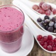 Smoothies from frozen black currant, red currant and gooseberry — Stock Photo #67899887