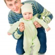 Beautiful dad holding the hands of his baby — Stock Photo #54187259