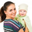 Beautiful mother holding the hands of his baby — Stock Photo #54187993