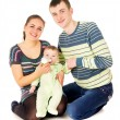 Happy the parents feeds baby — Stock Photo #54189953