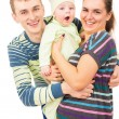 Happy parents holding the hands of his baby — Stock Photo #54189961