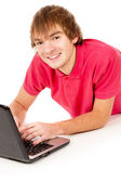 Beautiful guy student working on a laptop — Stock Photo