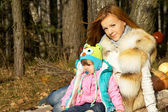 Autumn mother with baby on nature — Stock Photo