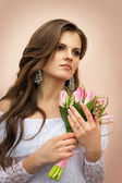 Beautiful bride holding a bouquet — Stock Photo