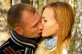 Beautiful couple in love in the forest nature — Stock Photo