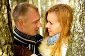 Beautiful couple in love in the forest — Stock Photo