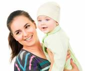 Beautiful mother holding the hands of his baby — Stock Photo