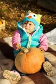 Fall picnic, a child with a pumpkin — Stock Photo