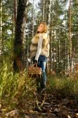 Girl walking in the woods with a basket — Stock Photo