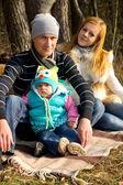Happy family on nature autumn — Stock Photo
