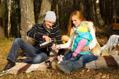 Happy family resting on the nature — Stock Photo