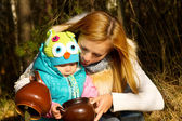 Happy mother with baby on nature in the forest rest — Stock Photo