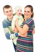 Happy parents holding the hands of his baby — Stock Photo