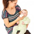The mother feeds her baby — Stock Photo #54190857