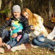 Young happy family outdoors in the woods — Stock Photo #54191237