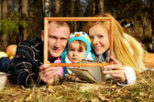 Portrait of happy family on nature autumn — Stock Photo