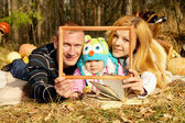 Portrait of happy family on nature — Stock Photo