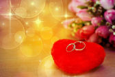 Ring newlyweds lie on heart — Stock Photo