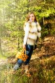 Young girl in the woods with a basket — Stock Photo
