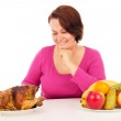 Full woman chooses what to eat — Stock Photo #64071563